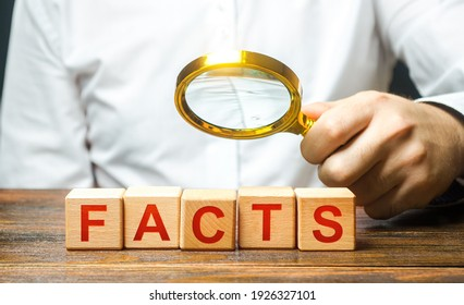 Man examines the blocks with word facts with a magnifying glass. Checking facts and data for plausibility. Debunking fakes and counter propaganda. Conspiracy, mistrust of official information sources