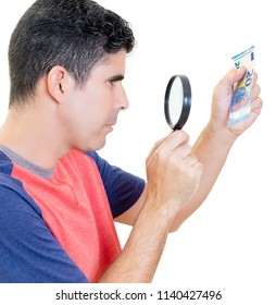 Man examines twenty euro bill with a magnifying glass isolated on white