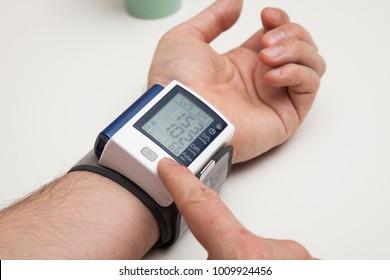 Man is examining blood pressure. High blood pressure.