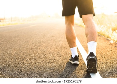 A man exercise by run on the road in the morning.