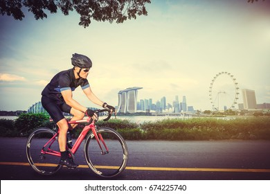 Man  exercising with bicycles outdoors