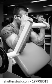 Man exercising with dumbbells.Black and white