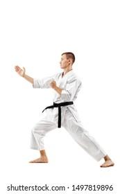 man exercising karate, against white background