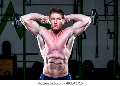 Man exercising with weights in a gym