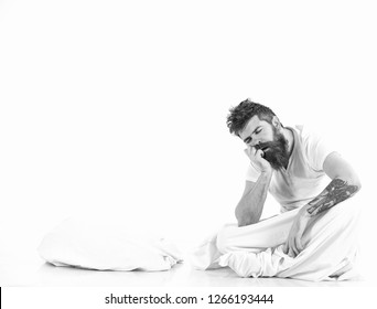 Man exhausted, needs relax, rest, nap, copy space. Fall asleep concept. Sleeping bearded man on white background. Hipster with beard and mustache fall asleep while sitting in bed.
