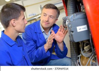 Man explaining equipment to trainee