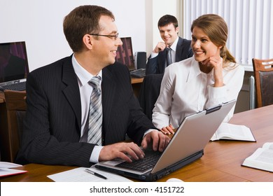 A man explains the marketing plan of work to his colleague in business environment
