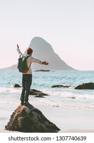 Man explorer enjoying sea view on empty beach traveling in Norway active vacations outdoor lifestyle adventure trip escape