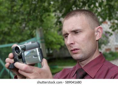 The man explores the possibilities of video camera