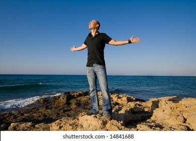 man expressing freedom with his arms wide open