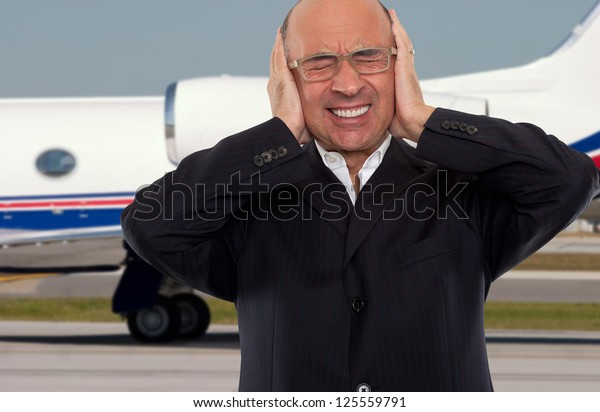 Man expressing stress and noise at the airport