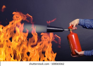 man with extinguisher fighting a fire