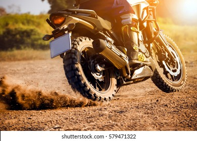 man extreme sport riding touring enduro motorcycle on dirt field