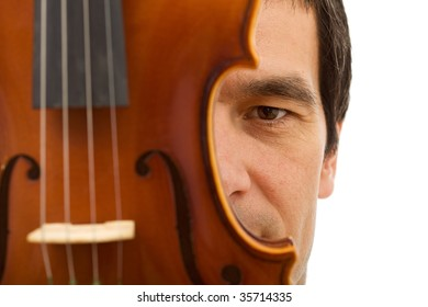 Man face hidden behind violin detail - closeup, isolated