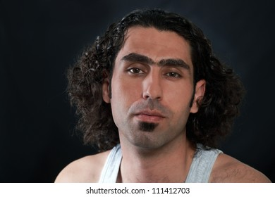 Man face with long curly hair