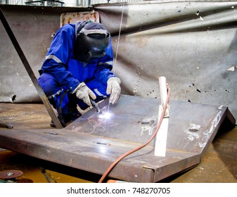 Man in the face mask welds with argon-arc welding in the maintenance job.Thailand