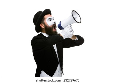 Man  with a face mime screaming into a megaphone, isolated on white background. concept of effective communication