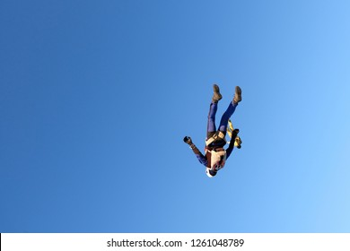 Man is falling in the blue sky.