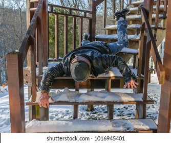 Man falling down snow steps.