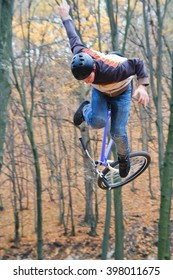Man falling off mountain bike on Track Cyclist falls during a training. Man riding on trampolines in the Dirt Jumping discipline.