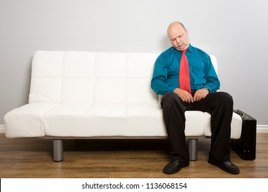 A man falls asleep waiting for appointment.