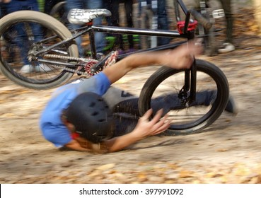 Man falls off his bicycle moto cross on track. Cyclist falls hard during a dirt jumping contest. The bike fell on man.