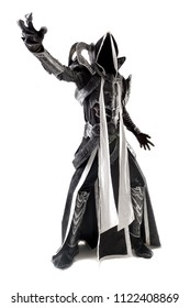 Man in a fantasy costume of a dark demon, cosplay, isolated in white