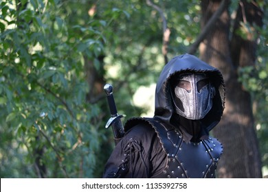 Man in fantasy leather armor and mask, original bounty hunter character