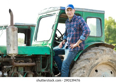 Man farmer driving tractor in the countryside
