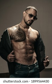 Man fashion undress. Bearded male with abs and sunglasses. Trend style macho in casual style clothes. Confidence and charisma