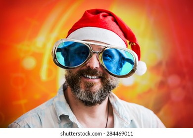 man with fashionable big beard in costume of Santa Claus and the big funny sunglasses