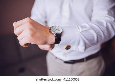 The man fastens dress watches