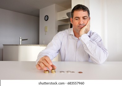 Man father (age 40 - 50) having financial problems. Money concept.  Real people. Copy space