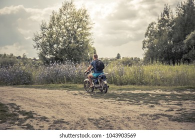 Man father son riding motorcycle countryside road concept road trip