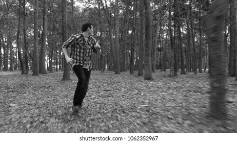 Man in fear running away from something in the forest.