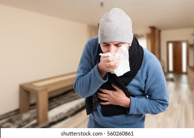 Man feeling bad and coughing in a napkin inside the house with advertising area