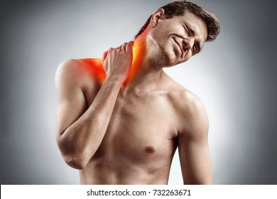 Man feeling exhausted and suffering from neck pain. Medical concept.