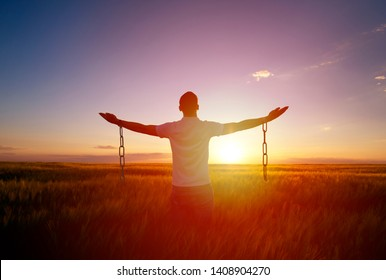 Man feeling free in a beautiful natural setting.