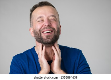 Man feeling great relief after cough, touching his throat and neck, being healthy.