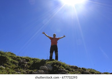 Man feeling happiness in the high of a mountain