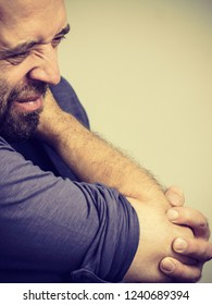 Man feeling pain in elbow having arm joints injury. Health rheumatism problems conept.
