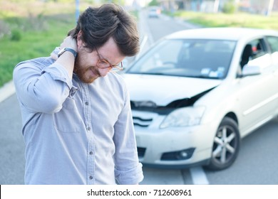 Man feeling pain to the neck after a car crash