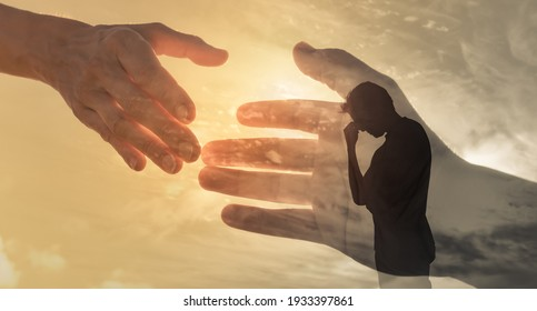 Man feeling sad and someone giving him a helping hand. Out of the darkness and into the light concept.