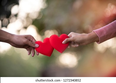 Man and Female hands holding a red heart, Valentine's day,Sign of Love,Health care,Valentine's day,World heart day Concept