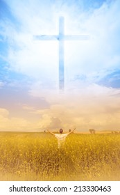 Man in the field worshiping God and the symbol of the Cross that appears in the sky