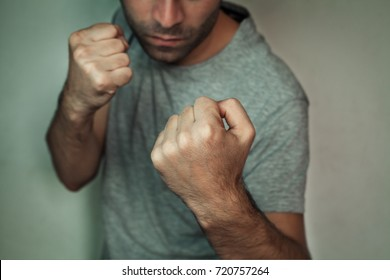 Man with fight gesture.