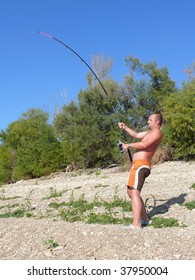 A man fighting with a catfish