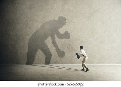 man fighting with his shadow, facing fears