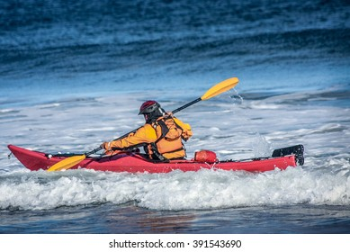 Man fighting the wave on kayak  on rough sea in Black Cove, Nova Scotia coast, Canada