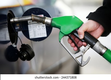 A man filling a car with petrol